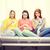 üç · üzücü · genç · kız · izlerken · tv · ev - stok fotoğraf © dolgachov