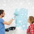 sorridente · casal · rolar · bandeja · pintura · parede - foto stock © dolgachov