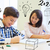 group of school kids writing test in classroom stock photo © dolgachov