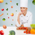 smiling female chef with vegetables stock photo © dolgachov