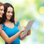 two smiling teenagers with tablet pc computer stock photo © dolgachov