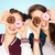 happy pretty teenage girls with donuts having fun stock photo © dolgachov