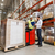 worker on forklift and businessman at warehouse stock photo © dolgachov