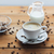 close up coffee cup and grains on wooden table stock photo © dolgachov