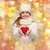 girl in winter clothes with small red heart stock photo © dolgachov