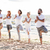 группа · людей · йога · дерево · создают · пляж - Сток-фото © dolgachov