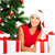 smiling woman in santa helper hat with gift boxes stock photo © dolgachov