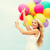 smiling woman with colorful balloons outside stock photo © dolgachov