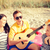 group of friends with guitar having fun on beach stock photo © dolgachov