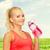 kobieta · pitnej · manierka · młodych · niebieski - zdjęcia stock © dolgachov