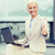 smiling businesswoman working with laptop outdoors stock photo © dolgachov