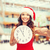 smiling woman in santa helper hat with clock stock photo © dolgachov