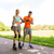 happy couple with roller skates riding outdoors stock photo © dolgachov