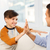 happy father and son doing high five at home stock photo © dolgachov