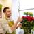 sonriendo · florista · hombre · rosas · personas - foto stock © dolgachov