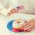 female hands decorating donut with american flag stock photo © dolgachov
