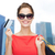 woman with shopping bags and credit card over city stock photo © dolgachov