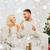 happy couple at home with christmas tree stock photo © dolgachov