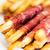 close up of grissini bread sticks with prosciutto stock photo © dolgachov