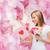 kobieta · kwiaty · czytania · Uwaga · uśmiechnięta · kobieta - zdjęcia stock © dolgachov