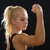 close up of athletic woman flexing her biceps stock photo © dolgachov