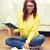 mosolyog · diák · tinédzser · olvas · könyv · kanapé - stock fotó © dolgachov