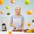 smiling woman with blender preparing fruit shake stock photo © dolgachov