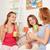 feliz · las · mujeres · jóvenes · potable · té · dulces · casa - foto stock © dolgachov