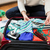 close up of woman packing travel bag for vacation stock photo © dolgachov