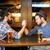 masculina · amigos · pulseada · bar · pub · personas - foto stock © dolgachov