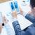 equipe · de · negócios · olhando · tela · empresário · sessão · mesa · de · escritório - foto stock © dolgachov