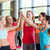 group of women making high five gesture in gym stock photo © dolgachov