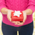close up of woman in pink sweater holding gift box stock photo © dolgachov