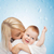 happy mother kissing smiling baby stock photo © dolgachov