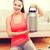 glimlachend · tienermeisje · jar · eiwit · home · fitness - stockfoto © dolgachov