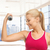 close up of sporty woman flexing her bicep stock photo © dolgachov