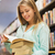 happy student girl or woman with book in library stock photo © dolgachov