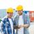 mosolyog · építők · táblagép · kint · üzlet · épület - stock fotó © dolgachov
