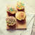 close up of glazed cupcakes or muffins on table stock photo © dolgachov