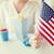 mano · bengala · bandera · de · Estados · Unidos · americano · día - foto stock © dolgachov