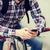 hipster man in earphones with smartphone and bike stock photo © dolgachov