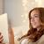若い女性 · インターネット · ベッド · 笑みを浮かべて · ラップトップを使用して · コンピュータ - ストックフォト © dolgachov
