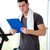 trainer with clipboard standing in a bright gym stock photo © dotshock