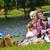 gelukkig · gezin · spelen · samen · picknick · buitenshuis · gelukkig - stockfoto © dotshock