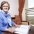 Senior Businesswoman about to Write stock photo © eldadcarin