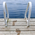 footprints on dock at summer lake stock photo © elenaphoto