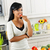 young woman tasting vegetables in kitchen stock photo © elenaphoto