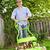 człowiek · trawnik · uśmiech · ogród · zielone - zdjęcia stock © elenaphoto