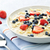 Bowl of oatmeal with berries stock photo © elenaphoto