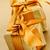 dourado · papel · de · embrulho · arco · apresentar · decoração · natal - foto stock © elenaphoto